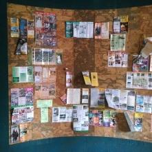 The cork board outside the registration desk