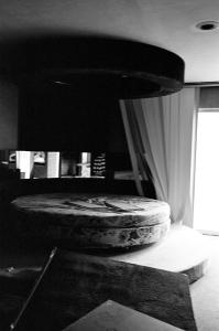 The most common bed: circular, rotating, shag carpeting on the walls, and mirrors on the walls and ceiling