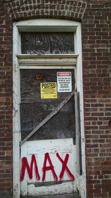 """Several of the buildings were posted with this sign reading, """"This building has potential waste contamination and unsafe conditions! Do not enter!"""""""