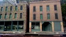 To the left is the The Goodman-Kincaid Building, which housed stores and two floors of apartments until residents moved out in 1959 when the roof started to collapse.