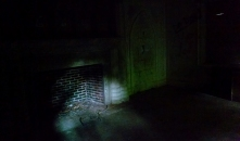 A fireplace in the dark - perhaps Josephine's chamber?