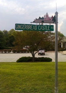 One other neat detail was this street sign. All of the other streets in the neighborhood had fairytale names (Wishing Well Rd., King Cole Rd., etc.), as well as their own Gingerbread Castle floating above it.